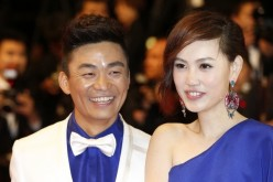 Chinese actor Wang Baoqiang (L) and his wife Ma Rong pose on May 17, 2013 as they arrive for the screening of the film 'Tian Zhu Ding' (A Touch of Sin) the Cannes Film Festival.