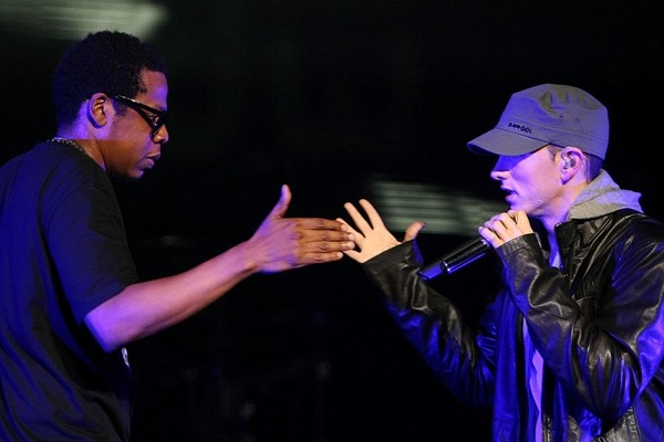 Rappers Jay-Z and Eminem perform together on-stage at the launch of 'DJ Hero' at the Wiltern Theatre on June 1, 2009 in Los Angeles, California.