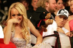 Lindsay Lohan reacts to the insult dog performed by Eminem during the 2005 MTV Movie Awards at the Shrine Auditorium June 4, 2005 in Los Angeles, California.