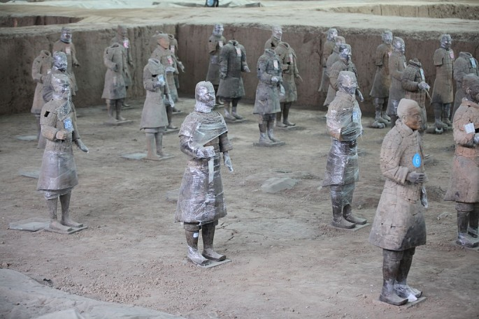 Some of the Terracotta Warriors in Xi'an, Shaanxi Province, are covered with protective plastic as they were being restored.