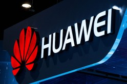 A logo sits illuminated outside the Huawei pavilion during the second day of the Mobile World Congress 2015 at the Fira Gran Via complex on March 3, 2015, in Barcelona, Spain.