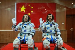 Chinese astronauts Jing Haipeng and Chen Dong during the send-off ceremonies for their mission aboard the Tiangong 2 space station.