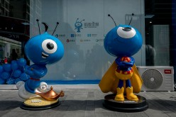 Mascots of Ant Financial, the country's leading fintech company, is displayed during the launching of an integrated wealth management app.