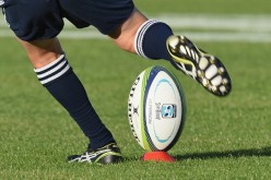 A rugby ball is kicked during a rugby match on March 19, 2016, in Christchurch, New Zealand.