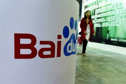 A woman walks toward a booth owned by Baidu at the China (Shanghai) International Technology Fair in Shanghai in April.