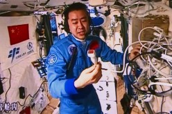 Chen Dong, one of the two astronauts in the Tiangong-II, introduces the equipment used for the in-orbit ultrasonic inspection to test their cardio-pulmonary function, on Oct. 30, 2016.