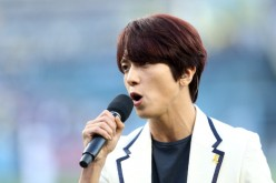 South Korean singing starJung Yong-Hwa performs the South Korean national anthem as part of 'Korea Night' fesitvities before the game between the Los Angeles Dodgers and the Cincinnati Reds at Dodger Stadium on May 27, 2014 in Los Angeles, California.
