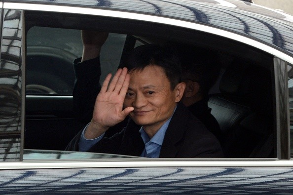 Alibaba founder and chairman Jack Ma waves as he leaves a hotel in Singapore following a meeting with investors in 2014.