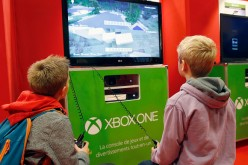 Children play the video game 'Minecraft' on Microsoft Xbox One console during the 'Paris Games Week'on October 27, 2016 in Paris, France. 'Paris Games Week' is an international trade fair for video games to be held from October 27 to October 31, 2016.