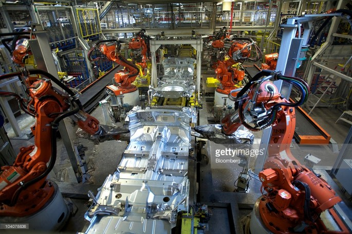 Robots work on an automobile at a Volvo production plant in Sweden.