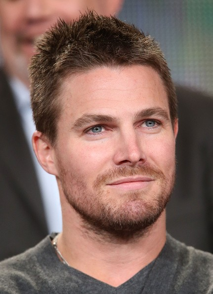 Actor Stephen Amell listens onstage to the panel discussion during the 'Arrow' and 'The Flash' panel as part of The CW 2015 Winter Television Critics Association press tour at the Langham Huntington Hotel & Spa on January 11, 2015 in Pasadena, California.