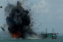 Indonesian Navy blows up foreign fishing boats caught illegally fishing in its waters in 2016.