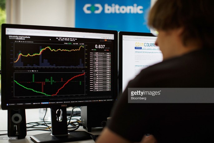 An employee of a Dutch financial company monitors the bitcoin exchange rate on his computer.