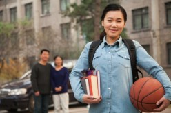 Books, ball and a belle: Chinese students studying abroad impressed the school of their choice either by their grades or background in sports--sometimes even by both.