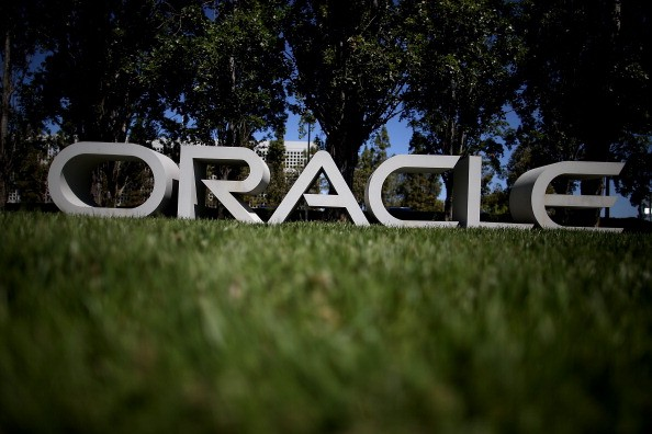 The Oracle logo is displayed in front of the Oracle headquarters on June 19, 2014, in Redwood Shores, California.
