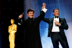 Jackie Chan is congratulated by fellow actor Sylvester Stallone (R) after accepting his Honorary Award at the 8th Annual Governors Awards in Los Angeles, California, U.S., Nov. 12, 2016.