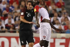 Trinidad and Tobago striker Kenwyne Jones (R) competes for the ball against Team USA's Steve Birnbaum.