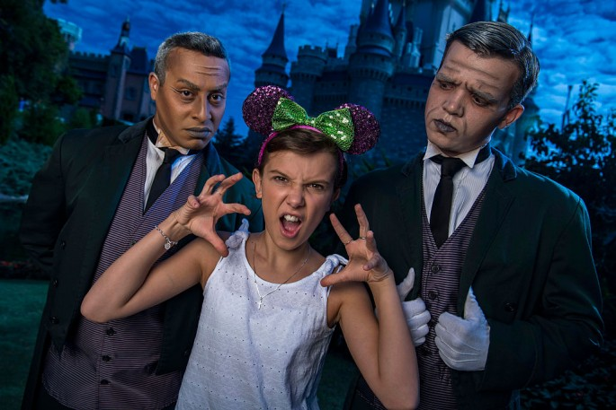 Netflix's 'Stranger Things' star Millie Bobby Brown, known as 'Eleven,' a girl with super powers against evil forces, poses with two 'grave diggers' at Magic Kingdom Park 6 in Lake Buena Vista, Florid