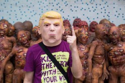 A man wears a Trump mask made in a factory in Shenzhen.