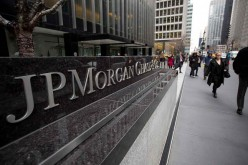 Pedestrians walk past a signage of JPMorgan in its headquarters in New York.