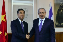 Chinese Vice Premier Wang Yang shakes hands with Israel Prime Minister Benjamin Netanyahu during their meeting in West Jerusalem in November last year.