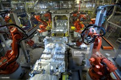 Robotic arms work at a car assembly manufacturing plant in Beijing.