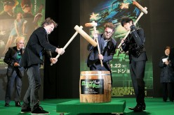 Director Michel Gondry (2nd L), actor and producer Seth Rogen (C) and actor Jay Chou (2nd R) pound rice cake during the Japan Premiere of 'The Green Hornet.'