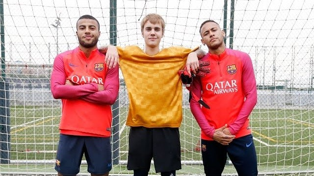 Justin Bieber poses with Neymar and Rafinha following a short training session in Barcelona.