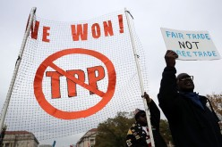 Americans march to hold a protest against the Trans-Pacific Partnership (TPP) deal in Washington, D.C.