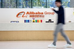 An employee walks past the reception counter at Alibaba headquarters in Hangzhou.