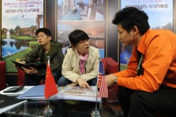 Chinese real estate investors inquire about United States property for sale at the Overseas and China Property Expo in Beijing.
