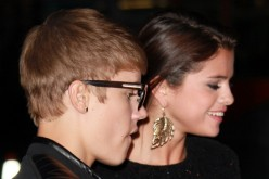 Recording artist Justin Bieber (L) and singer/actress Selena Gomez attend the premiere of Lionsgate Films' 'Abduction' at Grauman's Chinese Theatre on September 15, 2011 in Hollywood, California.