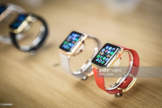 Apple Watch in various colorful straps.