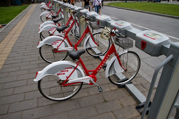 Bicycles are parked in a row at a bike-sharing station in Beijing.