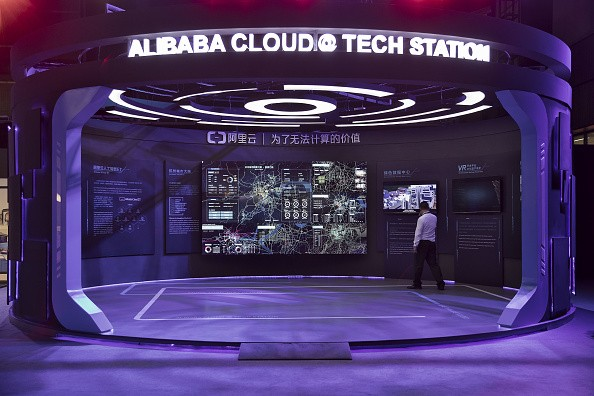 A visitor looks at Alibaba Cloud's display booth during the Singles' Day event.
