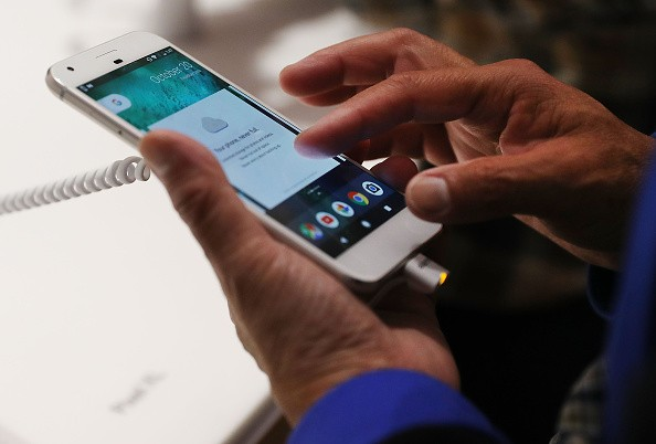 A person tries a new Google Pixel phone at the Google pop-up shop in the SoHo neighborhood on Oct. 20, 2016 in New York City.