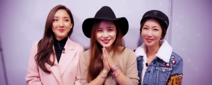 (L-R) S.E.S. members Sea or Bada, Eugene and Shoo greet their fans in a video clip.
