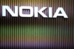 A logo sits illuminated outside the Nokia pavilion during the second day of the Mobile World Congress 2015 at the Fira Gran Via complex on March 3, 2015 in Barcelona, Spain.