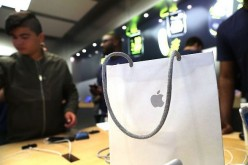 People buy the new iPhone's at an Apple store in Manhattan on September 16, 2016 in New York City.