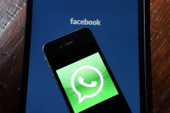 Facebook and WhatsApp logos are displayed on portable electronic devices on Feb. 19, 2014 in San Francisco City.