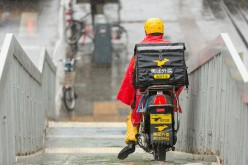 A food courier en route to deliver meals in Beijing.
