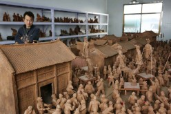 Miao Chunsheng's house is filled with clay sculptures.