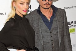 Actors Amber Heard (L) and Johnny Depp attend the 'The Rum Diary' New York premiere at the Museum of Modern Art on October 25, 2011 in New York City.