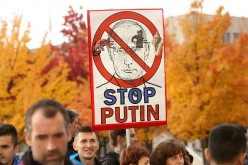 Russian President Vladimir Putin criticised by protestors for military operations in Syria.