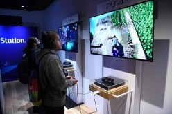 Fans try out PlayStation 4 Pro demos at the midnight launch event at Sony Square NYC on November 9, 2016 in New York City.