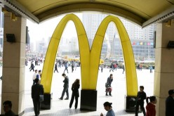 People walk past a McDonald's restaurant on April 21, 2007 in Shenyang of Liaoning Province, China.