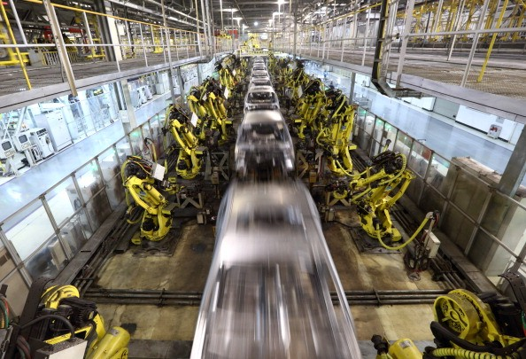 Robots are seen at work in a car manufacturing facility in Beijing.