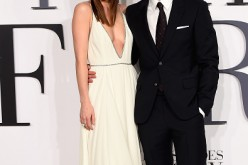 Dakota Johnson and Jamie Dornan attend the United Kingdom premiere of 'Fifty Shades Of Grey' at Odeon Leicester Square on February 12, 2015 in London, England.