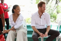 Prince Harry (R) watches as Singer Rihanna (L) gets her blood sample taken for an live HIV test, in order to promote more widespread testing for the public at the 'Man Aware' event held by the Barbados National HIV/AIDS Commission on the eleventh day of a