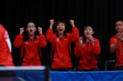 (From L-R) Wong Chin-yau, Minnie So, Mak Tze-wing and coach Li Ching cheer on Liu Qi in the team event at the junior World Championships in Cape Town.